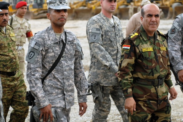 Iraqi Army Col. Ahmed-Alswedy (right),  commander of the 6th IA engineers, shows off his large stockpile of engineer equipment to Pineville, La. native, Col. Owen Monconduit, commander of the 225th Engineer Brigade, 1st Cavalry Division, Multi-National Division-Baghdad, Jan. 9.