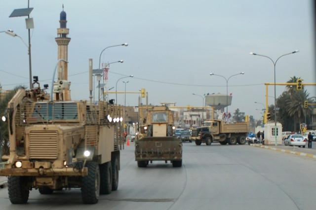 Soldiers from the 688th Mobility Augmentation Company, 890th Engineer Battalion, 926th Engineer Brigade, Multi-National Division - Baghdad search the busy streets of Baghdad for rubbish and explosive devices during a routine route sanitation mission Feb 7.