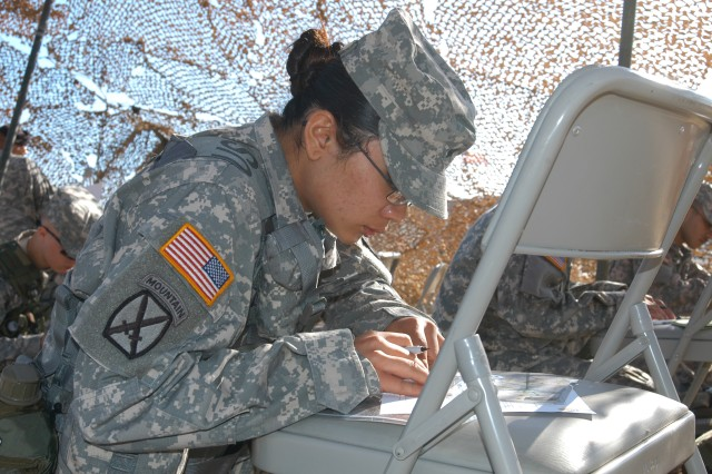 Staff Sgt. Joanna Yanz, formerly of Louisville , Ky., plots coordinates on a map as part of the Network Enterprise Technology Command/9th Signal Command (Army) Noncommissioned Officer of the Year competition, June 17, 2008. Yanz is the personnel services noncommissioned officer-in-charge for NETCOM/9th SC (A).