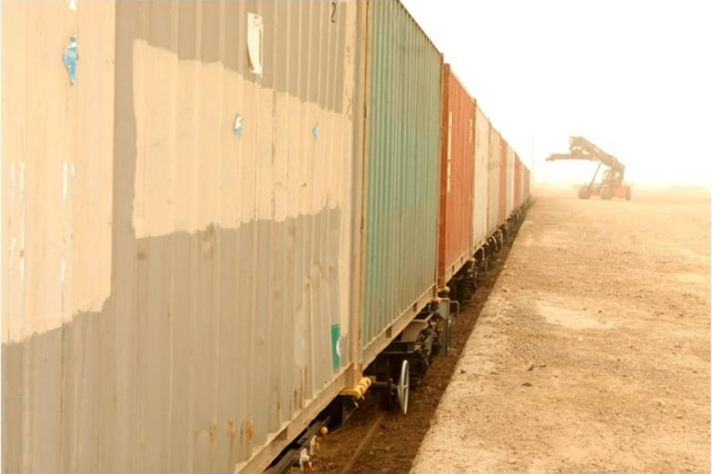 Loaded containers wait on the tracks during the proof of principle rail mission Feb. 10, 2009, at Camp Taji, Iraq. Forty empty containers began their two-day trip from here to the port city of Umm Qasr. 