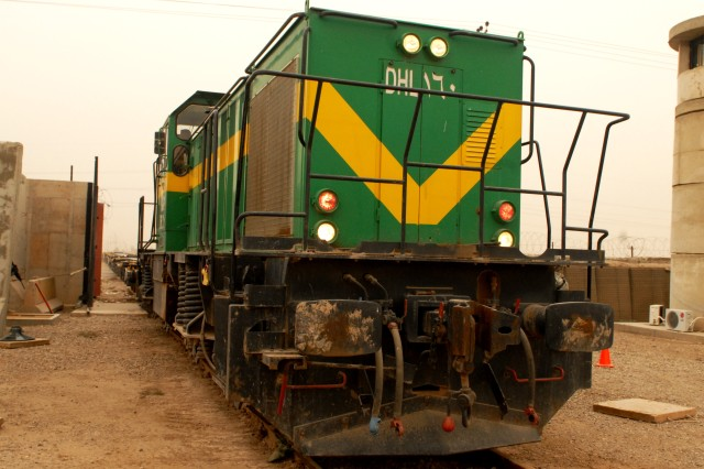 An Iraqi Railroad locomotive arrives at Camp Taji on Feb. 10, 2009, to begin a rail operation moving 40 containers from Camp Taji to the port city of Umm Qasr. 