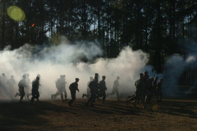 Soldiers burst through clouds of smoke Feb. 6 at Marne Obstacle Course, running to their awaiting positions to be awarded the Expert Infantry Badge after several weeks of training and preparation.