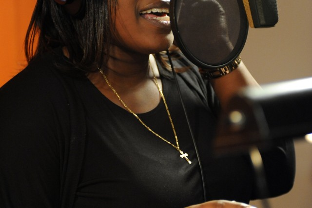 "Operation Rising Star winner Joyce Dodson sings ""Faith and Hope"" at DMI Music's Firehouse Recording Studios in Pasadena, where she recorded a three-song CD as part of her prize package for winning the Army Family and Morale, Welfare and Recreation Command-sponsored singing contest."