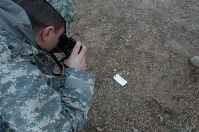 Lifto takes a picture of an artifact. The  U.S. Army Reserve Command historians trained MHDs information-gathering techniques Jan. 25 through Feb. 6 at the Catoosa Training Base, Tunnel Hill and the Chckamauga and Chattanooga National Military Park.