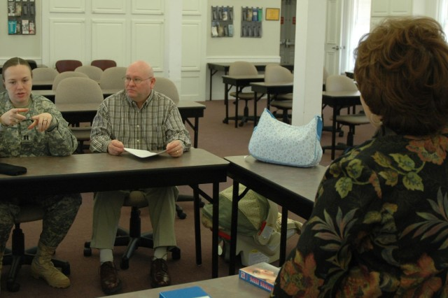 Capt. Ashley Bratton, executive officer for the Army Central (ARCENT) Operation Protec-tion Directorate, and her spouse, Steve, a school teacher, discuss parenting with Anne Murray, parent education specialist for the Army Commu-nity Services (ACS) Family Advocacy Program (FAP), ­­Jan. 31 during a Baby Care Workshop.