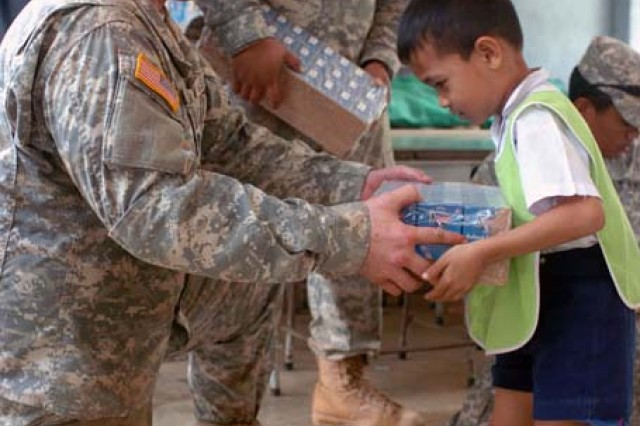 Spc. Salva Faatea distributes milk to the children of the Ban Pong Wua School in rural Thailand as part of the Cobra Gold joint humanitarian mission hosted at the Ban Nong Buatong School in the Chanthaburi District of Thailand Jan. 24 to Feb. 11.