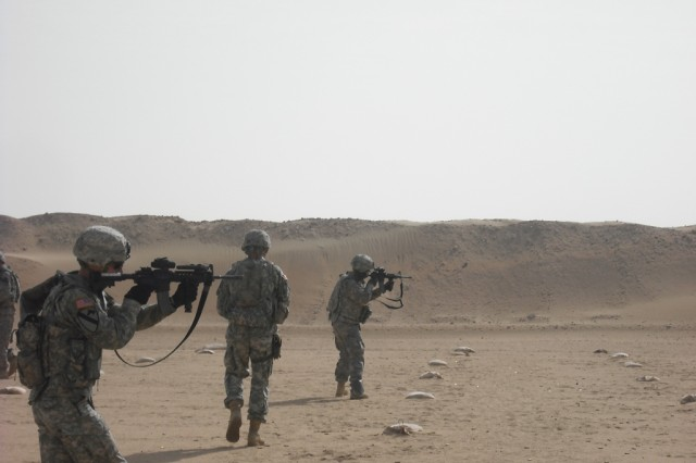 Soldiers from HHT and Troop B, 1st Bn., 7th Cav. Regt., 1st BCT, 1st Cav. Div., engage targets Feb. 8, during Close Quarters Marksmanship Training at Udari Range in Kuwait.  The training focused on engaging the enemy during dismounted patrols and applying proper techniques to maximize effectiveness while minimizing friendly casualties and collateral damage.