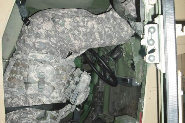 Pvt. Jason Failla, HHT, 1st Bn., 7th Cav. Regt., 1st BCT, 1st Cav. Div., of Murfreesboro, Tenn., releases his seatbelt and prepares to exit the vehicle after experiencing a 180-degree rollover simulation during HEAT.