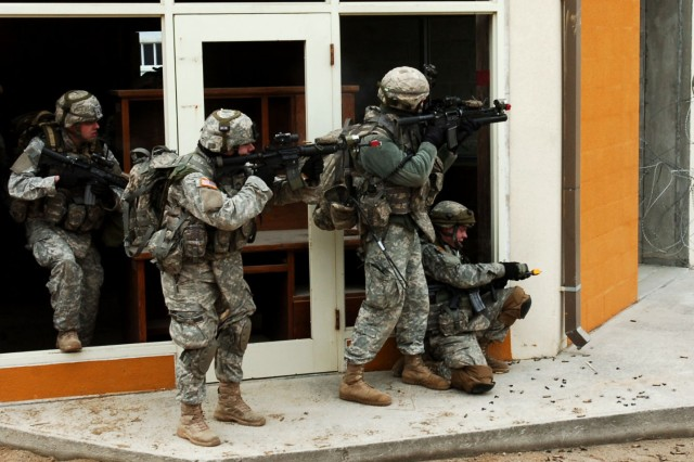 Soldiers from 1st Battalion, 72 Armor Regiment fight to defend their position as they assault a town at the Combined Arms Collective Training Facility in South Korea during Warrior Focus 09-01. The exercise utilized Live Virtual Constructive (LVC) training tools with focus at the battalion level.