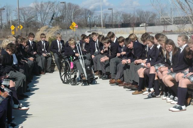 Students from the Episcopal School of Dallas gather at the Pentagon Memorial after a day meeting Army leaders, including Secretary of the Army Pete Geren.