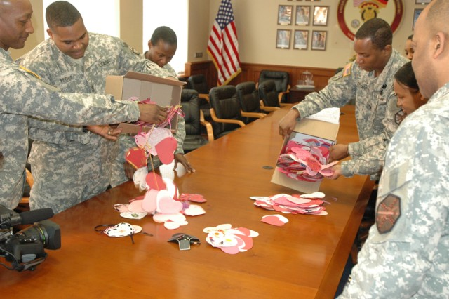 Command sergeants major from USAG Heidelberg, Mannheim and Kaiserslautern, along with representatives and leaders from tenant units, begin sorting the nearly 1,000 hand-made Valentine's cards sent to Soldiers in Germany from children in Nebraska.