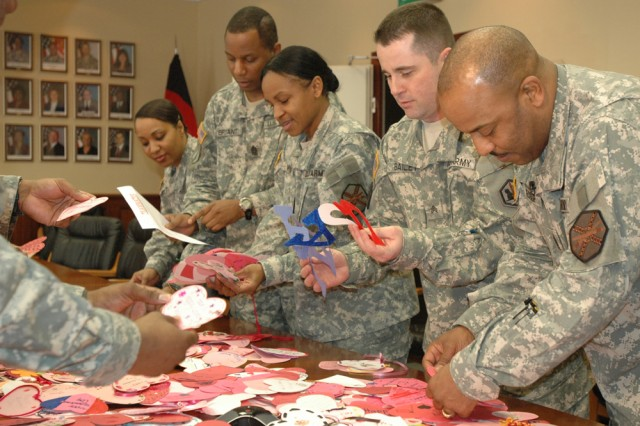 Command sergeants major from USAG Heidelberg, Mannheim and Kaiserslautern, along with representatives and leaders from tenant units, sort through the nearly 1,000 hand-made Valentine's cards sent to Soldiers in Germany from children in Nebraska.