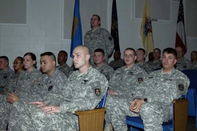 Sgt. Stephen Urbany Jr., assigned to U.S. Northern Command, stands as his name is read aloud as one of the inductees during the 2009 1st Space Brigade NCO Induction Ceremony conducted at the Peterson Air Force Base Auditorium on Feb. 5.