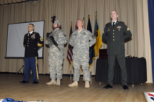 Several ranks of the Noncommissioned Officer Corps are represented by the following individuals during the 2009 1st Space Brigade NCO Induction Ceremony on Feb. 5. From left to right: 1st Sgt. William Edwards, HHC, 53rd Signal Battalion, represents the rank of first sergeant; Sgt. 1st Class Gregory Tidwell, 1st Space Battalion, represents the rank of platoon sergeant; Staff Sgt. Mark Bagwell, 1st Space Battalion, represents the rank of staff sergeant; and Sgt. Branden Kleiser, 1st Space Battalion, represents the rank of sergeant.