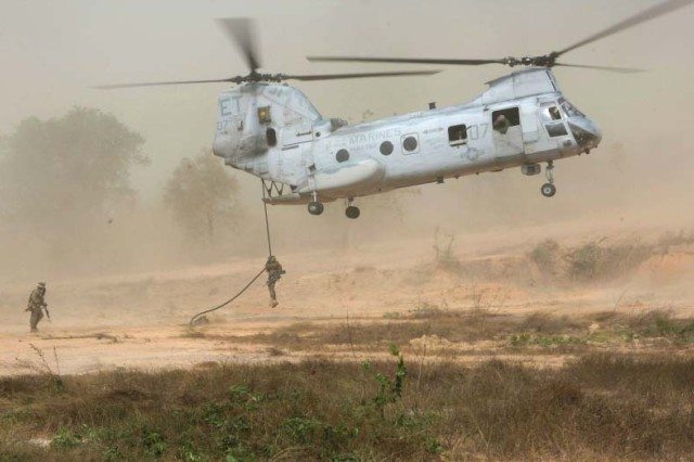 """SAMAESAN, Thailand (Feb 11, 2009) - Royal Thai Marines from 1st Battalion, 1st Marine Regiment, 1st Marine Division, and Marines and sailors with Kilo Company, 3rd Battalion, 5th Marines, 31st Marine Expeditionary Unit """"fastrope"""" from a CH-46 Sea Knight during bilateral helicopter raid training. The Royal Thai Marines, along with approximately 7,000 U.S. service members, are participating in Exercise Cobra Gold 2009 throughout the Kingdom of Thailand.  Cobra Gold '09 is a bilateral exercise focusing on military interoperability training and strengthening the long-standing partnership between the Royal Thai and U.S Armed Forces."""