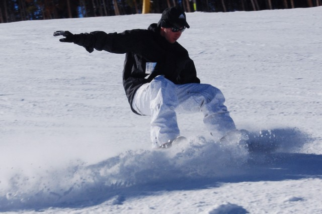 Staff Sgt. Patrick Dwyer of the 541 CSSB slides to a stop on the Schoolmarm trail at Keystone Resort, Colo. This was Dwyer's first time working with the Better Opportunities for Single Soldiers program.