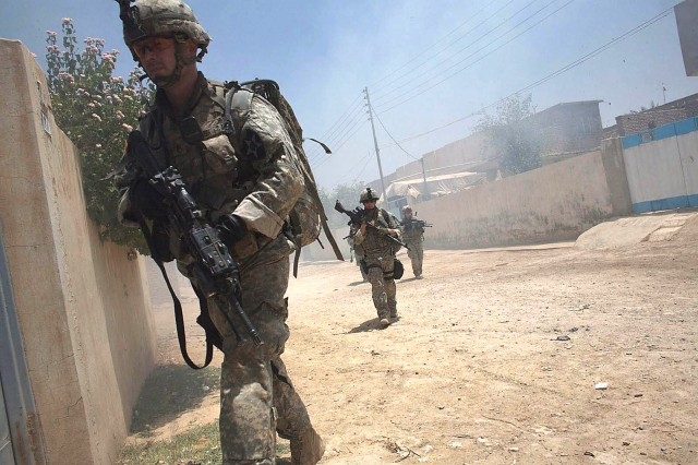 Staff Sgt. David Plush leads his weapons squad from 3rd Platoon, Company A, 5th Battalion, 20th Infantry Regiment, in the Khatoon District of Baqubah during Operation Arrowhead Ripper.