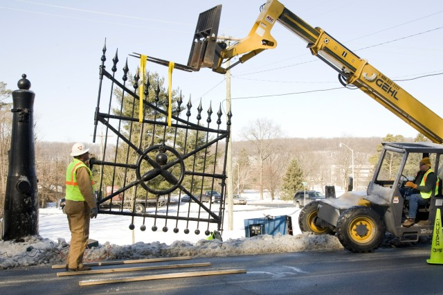 PICATINNY ARSENAL, N.J. - A worker guides part of the Cannon Gate after its removal. The gate was sent for much-needed repairs and should return in time for this year's Armed Forces Day celebration.