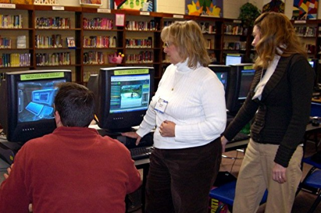 Teachers from Jefferson Township Middle School and High School work with National Defense Education Program Student Learning Modules at Jefferson Township Middle School. The Armament Research, Development and Engineering Center here, in conjunction with the Communications-Electronics Research, Development and Engineering Center at Fort Monmouth, is using the modules to inspire students to enter into science and engineering fields.