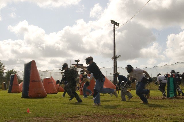 As the start of the game was announced, Soldiers run for cover behind inflatable barriers to avoid racing paintballs. Using battlemind tactics and teamwork, Soldiers from the 2/25th Stryker Brigade Combat Team participated in a competitive and fun game of paintball as part of the Warrior Adventure Quest program, Feb. 7.