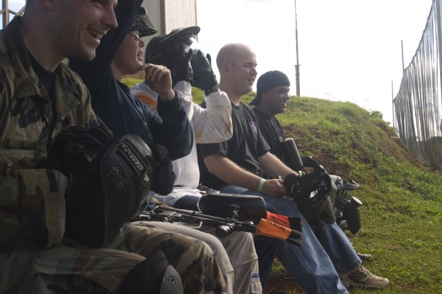 Soldiers from the 2nd Stryker Brigade Combat Team cheer on fellow Soldiers from the sidelines at Paintball Hawaii. The recently redeployed Soldiers participated in numerous games of strategic paintball as part of the Warrior Adventure Quest program.