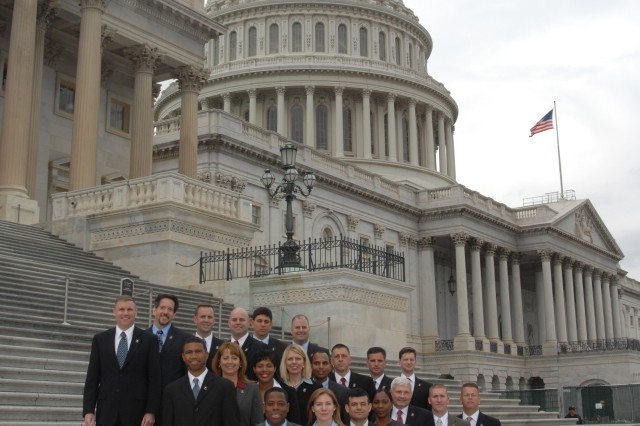 The current Army congressional fellows pose on the steps of the Capitol. Senior NCOs are now eligible for the program.