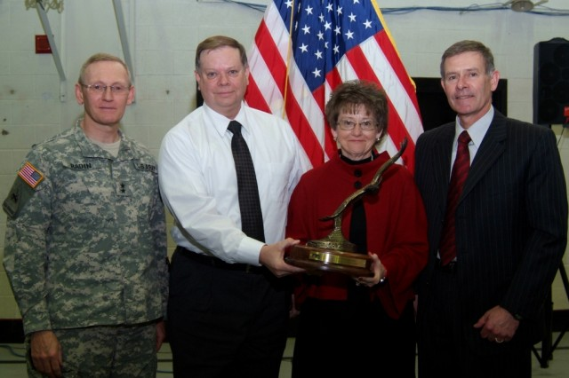 U.S. Army Garrison Rock Island Arsenal manager Joel Himsl (far right), and employees Ron Bass and Hollie Kensinger accept the 2008 Illowa Bi-State Combined Federal Campaign medium organization participation award from Maj. Gen. Robert M. Radin, Army Sustainment Command commander and Illowa Bi-State CFC honorary chair, at a ceremony held Feb. 10, 2009 at the Navy Operational Support Center Rock Island, Ill.