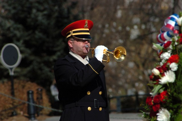 """A bugler from The United States Army Band (Pershing's Own) plays """"Taps"""" at a wreath laying to honor the presence of the Chief of Staff of the Army for the Republic of Korea at the Tomb of the Unknown Soldier in Arlington National Cemetery."""