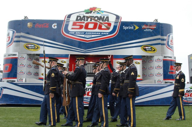 The United States Army Drill Team, 4th Battalion, 3rd U.S. Infantry Regiment (The Old Guard), perform their most difficult manuveur, the front to rear overhead rifle toss during a pre-show race at Daytona 500, Daytona Beach, Fl.