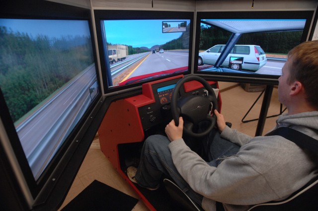 Matthew Chodzko, 17, Ramstein High School junior, is about to pass while driving using the U.S. Army Garrison Kaiserslautern's simulator Feb. 10 at Bldg. 2923 on Pulaski Barracks. Chodzko is one of 15 teens who graduated from the first Driver's Education Theory class sponsored by the garrison and the Department of Defense Dependent Shools. Photo by Christine June, USAG Kaiserslautern.