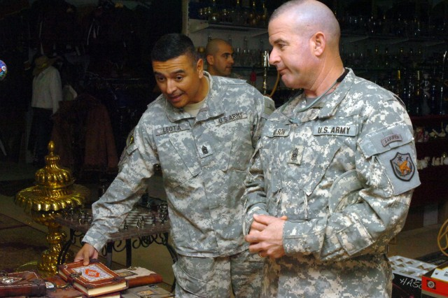 Command Sgt. Maj. Frank M. Leota, command sgt. maj., Multi-National Division - North, window shops with WilsonMulti-National Force - Iraq Command Sgt. Maj. Lawrence K., at the Turkish Mall on Contingency Operating Base Speicher, near Tikrit, Iraq, Feb. 17. (U.S. Army photo by Pfc. Jesus J. Aranda, Task Force Lightning Public Affairs)