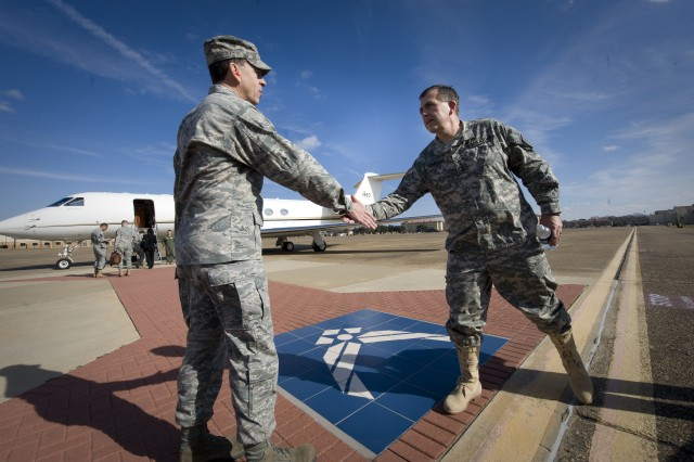 Vice Chief of Staff of the Army, GEN. Peter Chiarelli, shakes hands with Air Force Col. John Carter before leaving Maxwell AFB, AL on Jan. 23, 2009.  Chiarelli was in Maxwell to speak to the Air War College Class of 2009. U.S. Army photo by D. Myles Cullen