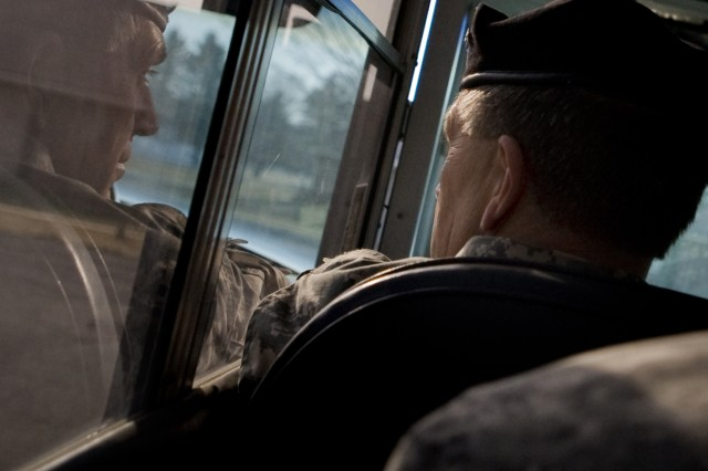 Vice Chief of Staff of the Army, GEN. Peter Chiarelli, looks out the bus window while being given a tour of the Muscatatuck training grounds at Camp Atterbury, IN on Jan. 23, 2009.  U.S. Army photo by D. Myles Cullen