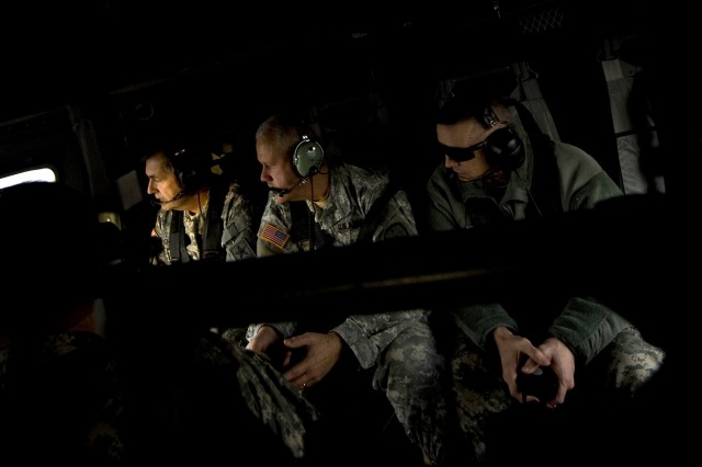 Vice Chief of Staff of the Army, GEN. Peter Chiarelli, Adjutant Gen. of Indiana, Maj. Gen. Martin Umbarger and Commanding Gen. of the First Army Division East, Maj. Gen. Michael Bednarek review the training facilites as they fly over Camp Atterbury, IN on Jan. 23, 2009.  U.S. Army photo by D. Myles Cullenhttps://core.us.army.mil/core/about/pages/draftPrompt.php?id=0&ch=50303,50306,50308,50315,50316