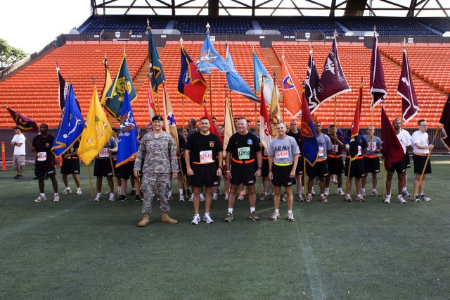 "The unit colors from all the participating Army units in the ""Sounds of Freedom"" division of the Great Aloha Run stand on the field of Aloha Stadium following the run, Feb. 16.  Pictured are Brig. Gen. Mark MacCarley, 8th Theater Sustainment Command, left, Col. Fabian Mendoza, 130th Engineer Brigade, Brig. Gen. John Seward, deputy commanding general, United States Army, Pacific, and Brig. Gen. Steve Jones, commanding general, Tripler Army Medical Center."
