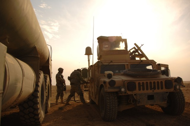 U.S. Army Soldiers attached to Task Force 1-77, 1st Battalion, 18th Infantry Regiment, 3rd Infantry Division refuel their vehicles during an operation at Camp Ramadi, Iraq.
