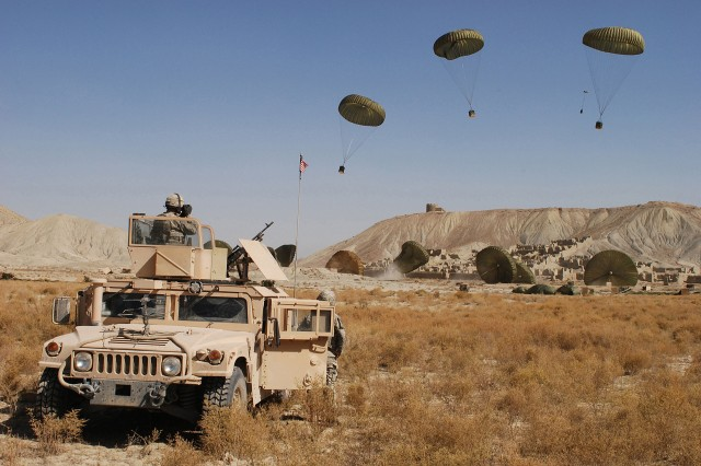 Paratroopers from the 782nd Brigade Support Battalion, 4th Brigade Combat Team, 82nd Airborne Division watch as combat delivery system bundles carrying food and water come floating to the ground in the Paktika province of Afghanistan.