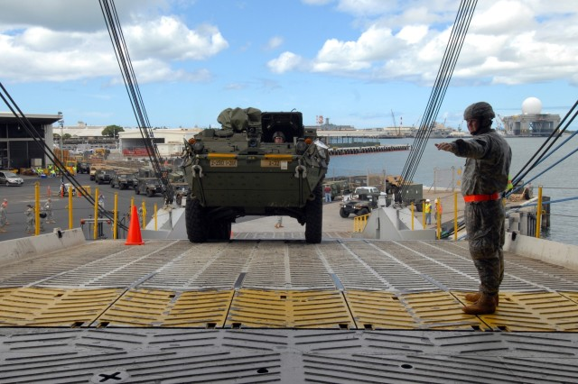 A Stryker vehicle from the 25th Infantry Division is loaded aboard the M/V Jean Anne at the Fleet Industrial Supply Center at Naval Station Pearl Harbor, Hawaii. The vessel will carry Army vehicles and equipment to the Port of Los Angeles, for overland transport to the National Training Center at Fort Irwin, Calif.