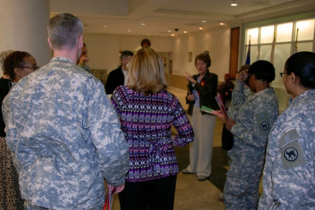 """Civilians and Soldiers assigned to the 81st Regional Support Command, meet with hospital staff members at the William Jennings Bryan Dorn Veterans Administration Hospital located in Columbia, S.C. Nearly a dozen Soldiers and civilians assigned to the Army Reserve Command, spent their lunch time visiting patients at the hospital during the national """"Salute Your Hospitalized Veterans"""" week."""