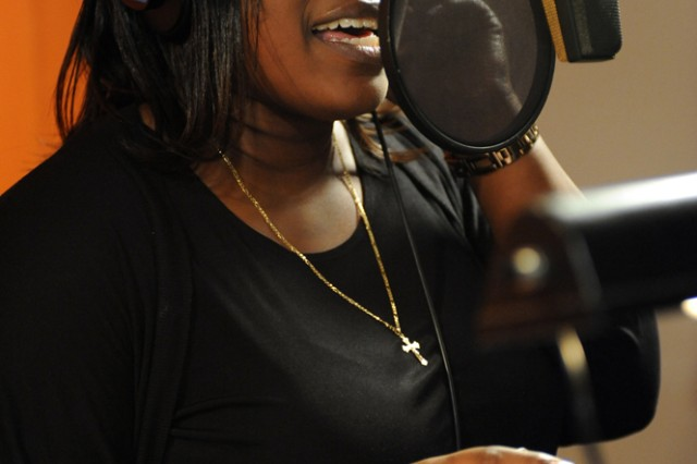"""Operation Rising Star winner Joyce Dodson sings """"Faith and Hope"""" at DMI Music's Firehouse Recording Studios in Pasadena, where she recorded a three-song, gospel CD as part of her prize package for winning the Army Family and Morale, Welfare and Recreation Command-sponsored singing contest."""