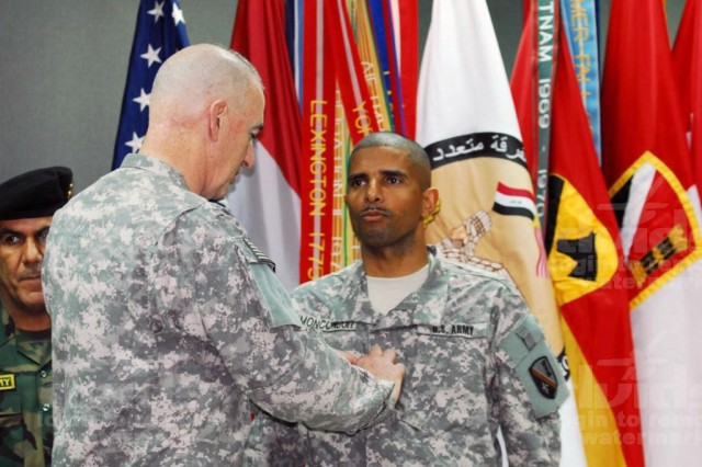 Maj. Gen. Daniel P. Bolger, commander of the 1st Cavalry Division, Multi-National Division - Baghdad, places Brig. Gen. Owen Monconduit's first star during his promotion ceremony, Feb. 17. Monconduit, of Pineville, La., is the first black general officer in the Louisiana National Guard. Monconduit commands the 225th Engineer Brigade, 1st Cavalry Division, MND-B.