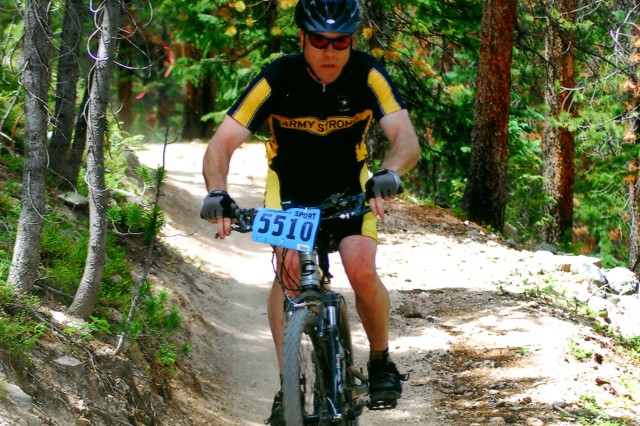 Spc. Michael A. Kurpil prepares for a downhill run during a 2008 race. He is currently the only Army-sponsored mountain bike racer.
