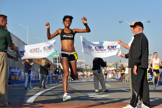 Veena Reddy of Centreville, Va., wins the women's division of the 24th running of the Army Ten-Miler with a time of 58 minutes, 8 seconds, Oct. 5, at the Pentagon.