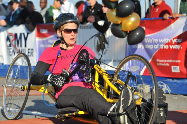 Hope Galley of Falls Church,  Va., wins the women's wheelchair division of the 24th running of the Army Ten-Miler with a time of 1 hour, 3 minutes, 31 seconds, Oct. 5, at the Pentagon.
