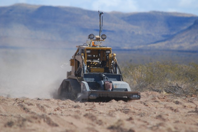 The All-Purpose Remote Transport System, or ARTS, is remotely operated and can maneuver different attachments to safely remove vegetation in an area that contains UXO.