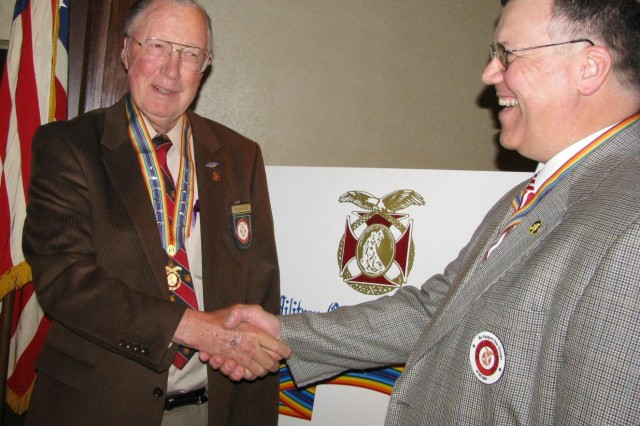 Sam Wetzel, retired lieutenant general who now commands the Military Order of the World Wars, is greeted by MOWW Huntsville chapter commander Rick Makowski during MOWW's mid-winter general staff conference in Huntsville. Wetzel is visiting MOWW chapters across the nation to encourage the order's message on national security, patriotism, good citizenship and service to country.