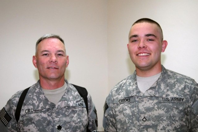 Lt. Col. Jerry Crooks (left) stands with his son, Pfc. Taylor Crooks, after the younger 225th Engineer Brigade Soldier was promoted to private first class.