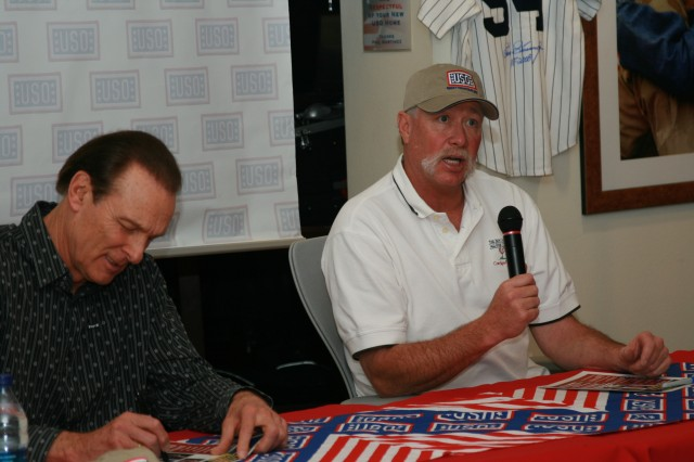 """FORT CARSON, Colo.-Major League Baseball Great """"Goose"""" Gossage, right, address Soldiers and Family members as former NBA Great Rick Barry, left, signs autographsduring a USO-sponsored autograph session at the Mountain Post Feb. 10."""