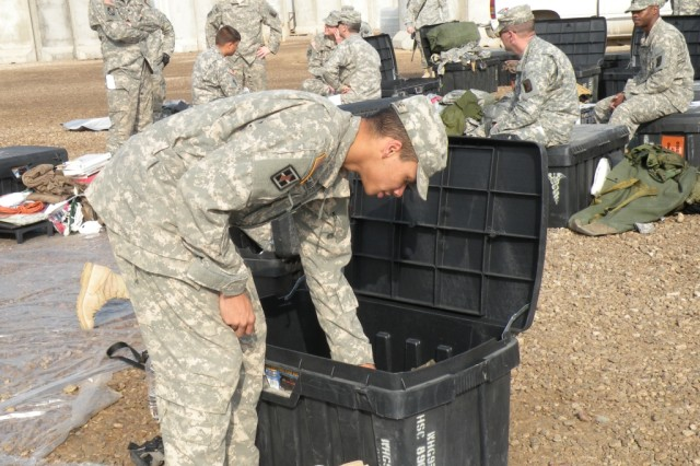CAMP LIBERTY, Iraq - Spc. Charles Gamache, a native of Pontotoc, Miss., inventories the items in his black box Feb. 9, before loading it on the shipping container headed back to the United States. The Soldiers of the 890th Engineer Battalion, of Gulfport, Miss., in Iraq since July 2007, will soon go home. Gamache is a member of the personal security detachment, Headquarters Support Company, 890th Engineer Battalion, 225th Engineer Brigade, Multi-National Division - Baghdad.