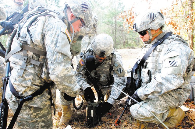 Soldiers in Co. B, 603rd ASB, prepare a radio for Warrior Task Training, a battalion-wide lanes training exercise, Feb. 11 at Hunter.